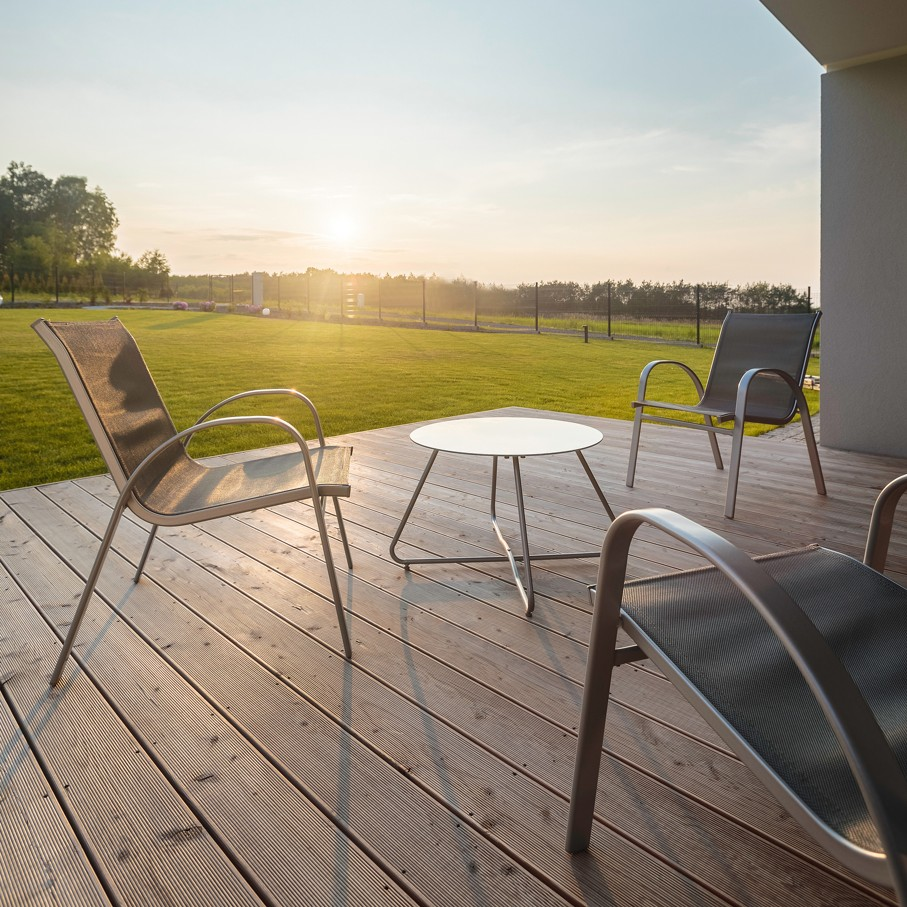 Sunset on modern patio with simple outdoor furniture